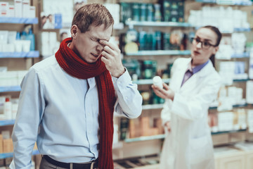 Illness man buys a medicament in pharmacy