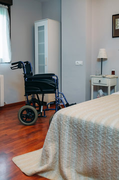 Cozy furnished empty clinic room with wheelchair