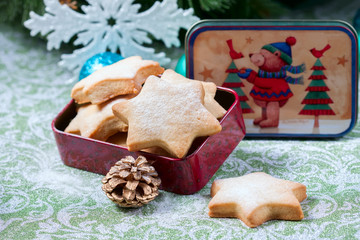 Homemade star shaped cookies on a wooden background. Christmas decoration
