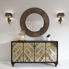 Luxurious art deco style dresser with gilded facade and patina. Round mirror over the chest and sconce.