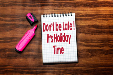 don't be late its party  text concept in notebook on wood table with pink felt pen