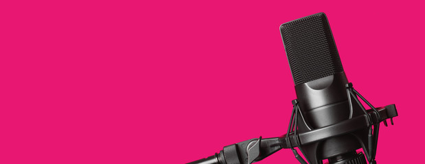 professional microphone isolated on pink