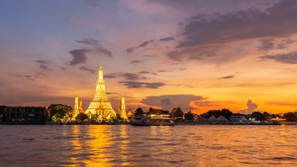 beautiful sunset wat arun temple chao phraya river, landscape Bangkok Thailand