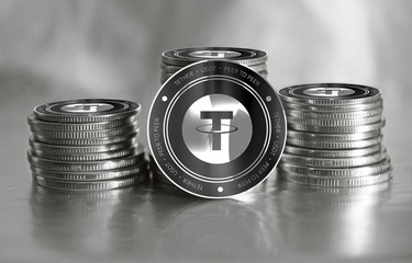 Tether (USDT) digital crypto currency. Stack of black and silver coins. Cyber money.