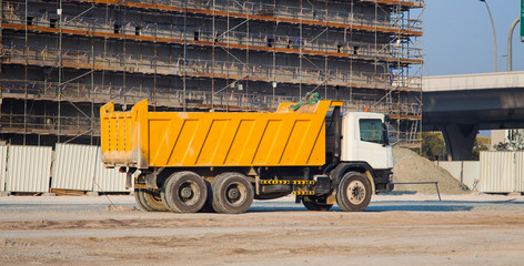 truck and building under construction. Dubai city