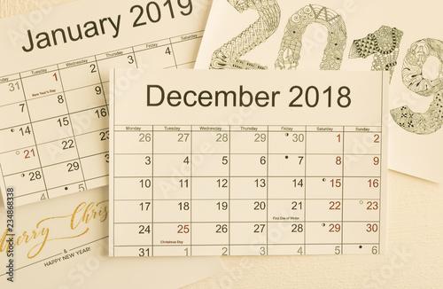 View A December 2019 Calendar With Holidays Close up: calendar December 2018 is on top of images of calendar