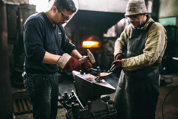 blacksmith working with metal