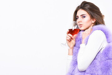 Lady curly hairstyle like expensive wine. Luxury life concept. Reasons drink red wine in wintertime. Alcohol and cold weather. Woman enjoy wine. Girl fashion makeup wear fur coat hold wine glass