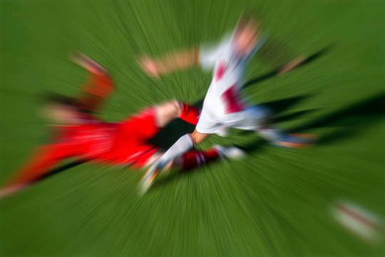 Blurred motion photo of  soccer players