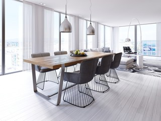 Designer dining table in the loft-style apartment with large hanging lamps, hardwood tabletop, creative chairs.