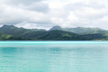 travel, seascape and nature concept - lagoon and mountains in french polynesia
