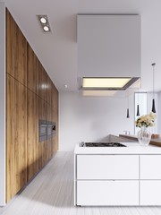 Minimalistic modern kitchen in white with elements of hardwood panels and countertops. Built-in appliances, pendant lamps and free-standing rectangular hood.