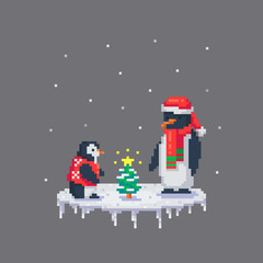 Penguins dressed up a little Christmas tree.