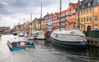 Tourist boat goes on Nyhavn, Copenhagen
