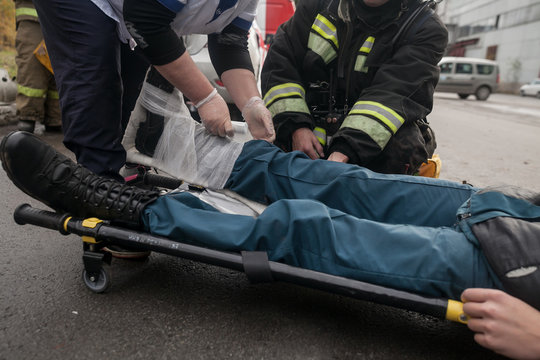 law enforcement team use light stretcher for medical evacuation to vehicle in training course
