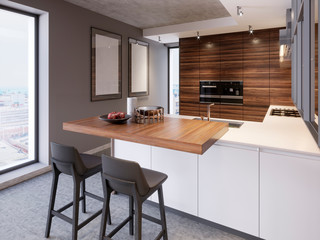 A kitchen with a kitchen island with two chairs in a modern kitchen, the style of contemporary and modern kitchen furniture.