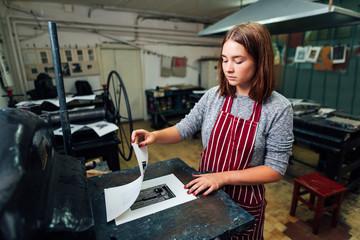 linocut. manual printing on the machine