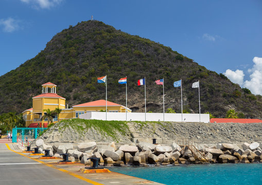 World flags infront of Dr. Wathey Pier on the Dutch side of St. Maarten