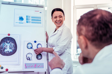 Happy Asian medical worker presenting results of research