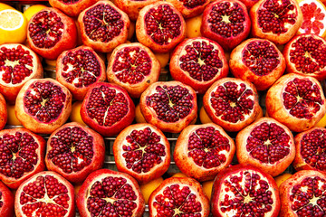 Ripe and juicy half of pomegranates ready for making juice.