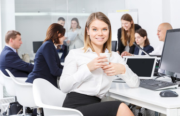 elegant girl in modern open plan office