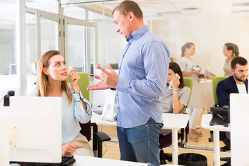 Dissatisfied manager talking to woman