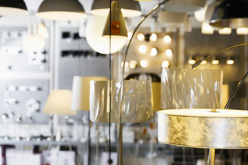 Picture of different modern lamp with lights in the store
