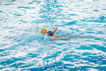 water polo competition in a pool for children and adolescents. water sports and swimming pool championship.