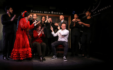 Chef David Garcia celebrates with flamenco performers and other restaurant staff at the Corral de la Moreria flamenco show restaurant during celebrations for being awarded a Michelin star, marking a first of its kind, in Madrid
