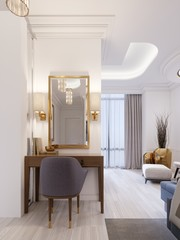 Designer working and dressing table made of wood with a mirror in a gilded frame and glowing sconces on the wall in the suite.