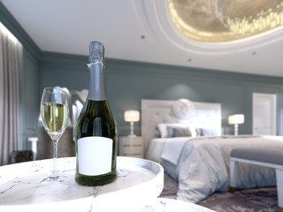 An open bottle of champagne with a glass of wine on the table in the bedroom, depth of field effect.