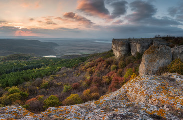 Autumn sunset / Amazing sunset view with rocks and autumn forest