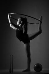 Poster de jardin Gymnastique Teenager girl involved in rhythmic gymnastics with gymnastic hoop