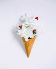 Lovely bouquet flower in ice cream cone on white background. Floral arrangement, flat lay styling. Top view.