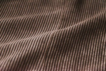 brown ribbed corduroy background. corduroy fabric texture