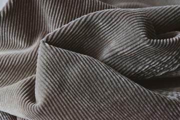 abstract grey ribbed corduroy background. corduroy fabric texture