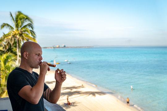 Smoking cigar in Cuba