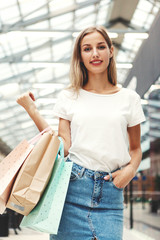 Pretty blond woman with shopping bags