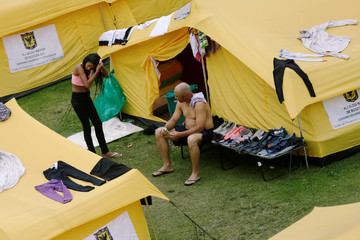 A Venezuelan girl combs her hair inside a temporary camp for Venezuelan migrants in Bogota