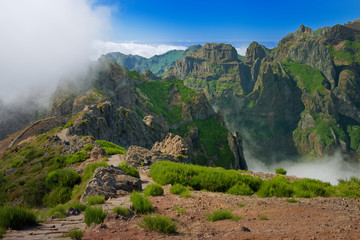 Green mountain range against blue sky on Portuguese island of Madeira