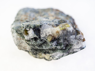 chrysoberyl crystals in rough beryl stone on white