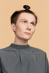 Portrait of serious woman with short hair and braid