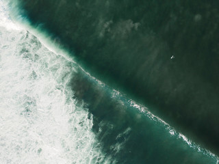 Indonesia, Bali, Aerial view of Balngan beach, surfer