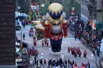 A toy soldier ballon is carried down 6th Avenue during the 92nd Macy's Thanksgiving Day Parade in New York City