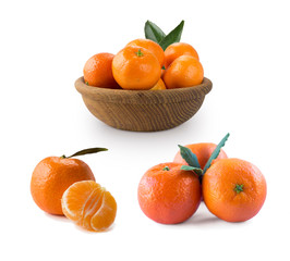 Set of fresh mandarins. Fresh tangerines with copy space for text. Slices of mandarin with leaves isolated on white background.Clementines slices isolated on white background