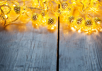 Background with lights for festive events in front of a wooden table