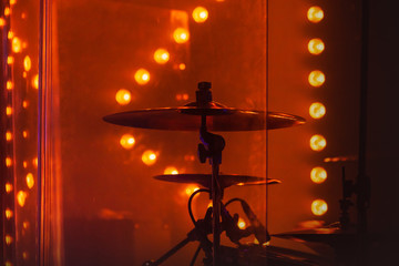 Drum set  with cymbals in red stage lights