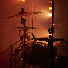 Rock drum set  with cymbals in red lights