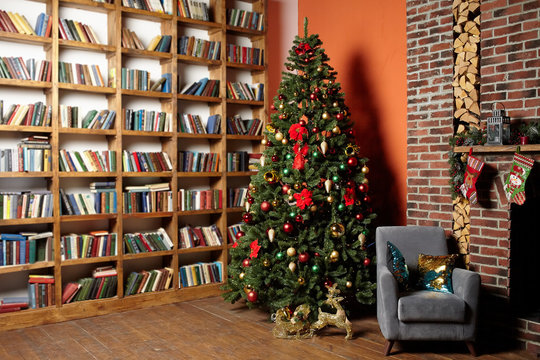 Christmas tree in the room near the fireplace and home library, the Christmas mood with gifts