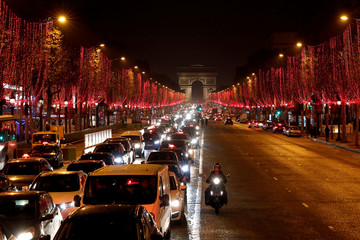 Champs-Elysee avenue is seen illuminated with the Christmas lights and the Arc de Triomphe in the background in Paris